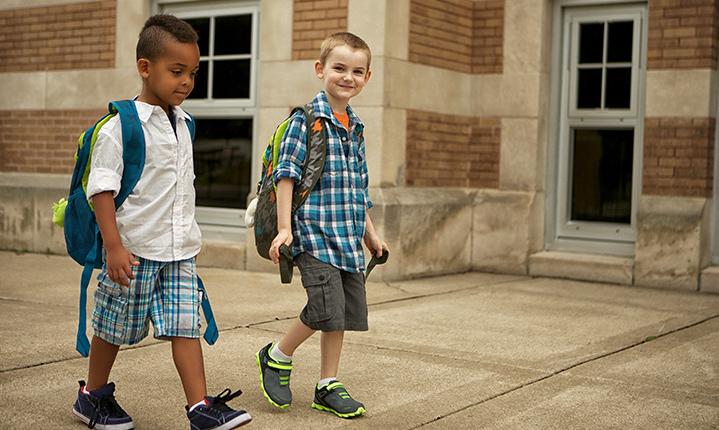 Two kids walking to school.