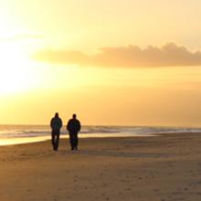 thumbnail of two mean walking on oak island beach